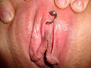 You have some great playful and sexy shots, but this closeup is the best. Such a great closeup of a beautiful pussy with a piercing. Very hot.