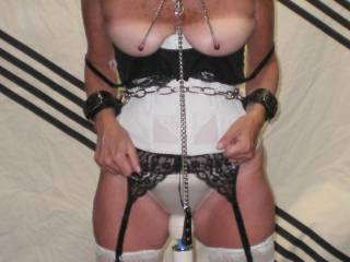The wife tits chained to the ceiling with the hitachi wand between her legs.  To make herself cum she had to squat down and pull her tits which she did should I post the video??