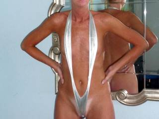 """No need to rip it off. That outit is sooooo easy to pull aside and uncover and expose your yummy horny and eager fuck holes at any time and any place, hunny. Perhaps some silver high stilettos will go excellent with your """"dress"""". Love how nicely your crotch and pussy gets barely covered!..."""