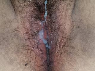 Shot a load all over her hairy pussy