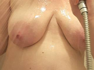Who likes how my heavy milk filled tits look all wet in the shower?