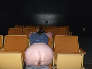 Hanging out in an adult theater, letting the guys use my pussy