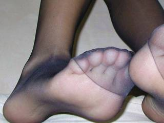 I would love to smell, lick, suck on and cum all over those sexy black nylon covered feet