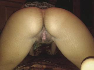 Wifey sexting and teasing one of her boyfriends on her cell phone.