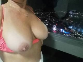 Im showing  my Tits to the city..Who wants to fuck me by the window?