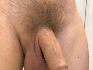 Nicely trimmed cock. Now what do I do with it?