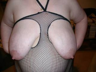 She loves to have her tits pulled, twisted, pinched, sucked, and splattered with cum