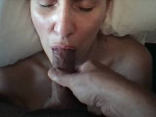 Hubby wanted his cock sucked while we were at a hotel, and since I had nothing else to do, why not!? He promised not to cum down my throat (since I didn't want the gag feeling that morning), so got him excited, moaned a bit, and got a nice wet facial. :)