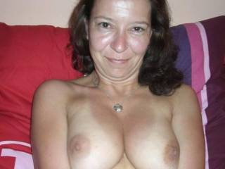 A lovely smile and awsome tits, what more could a man ask for