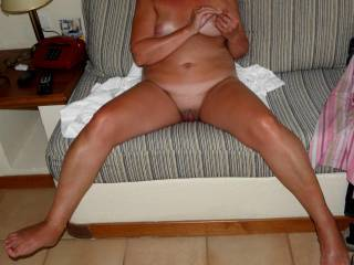 I love her legs.  If I could oil them for her I'd be a happy camper.  But then I'd have to kiss all the way up to her pussy and make oral love to her.