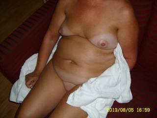 What you think about her small tits...........