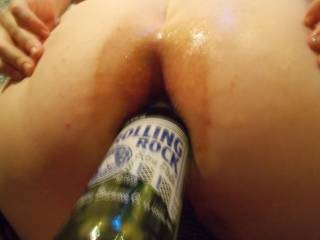 We got a little kinky, lots of lube and a condom on a beer bottle went into her ass, and she squirted like no tomorrow