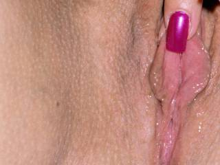 close up of me playing with my waxed and pierced pussy