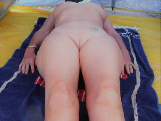 Avoiding the intense midday sun on a local nude beach.