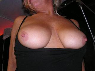 These are very beautiful tits!  I would love to be her dress...just rub against them all evening...  ;)