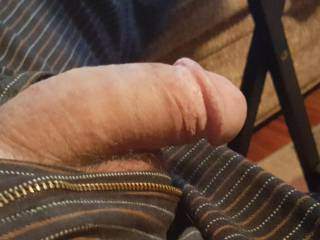 Waiting to go to work one day...I hadnt realized that my zipper was open until my cock started getting hard and popped out for all to see!