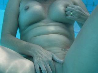 Relaxing in the swimming pool at home. Playing with my pierced nipples and pussy.