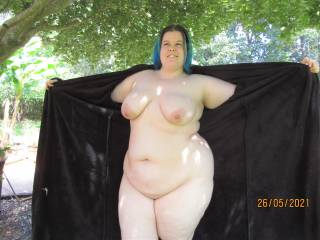 My wife flashing her big tits and chubby curves outdoors - would you like to be our neighbour and watch the show?