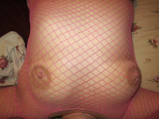 My big tits in my pink fishnet shirt.