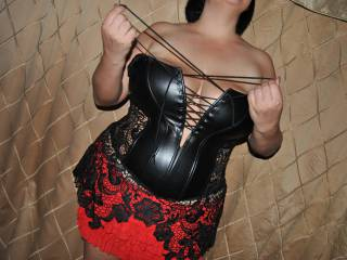 She's busting out of this corset