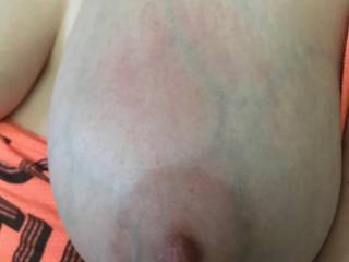 Close up of Kiki's big tit after being slapped a few times. Do you want to slap Kiki's tits?