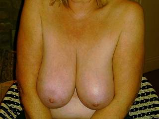 She loves to have me cum on her tits, and we would love to see you cum on them to.