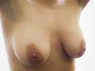 would love to be able to taste those sweet nipples and feel those beautiful breasts pressed against me