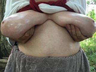 Presenting ... lovely big tits, oiled and held apart !