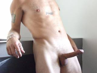 I would kiss the head of that cock then slowly part my lips and let it slide into my mouth.  As I lock my lips around that sexy cockhead. I'd start sucking and gently tugging on it at the same time.  I would enjoy your cockhead for a while before I start swallowing your entire cock.  Thats what I would do for starters.  K