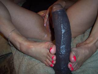 oh darlin please use the real thing, can i bring you my thick black cock and let you stroke it good til i shoot cum all over your pretty feet!!!!??