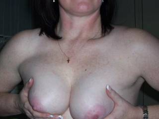 Her breasts for you.