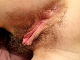 What a lovely hairy pussy and ass. Looks so delicious and so inviting too. Lucky guy.