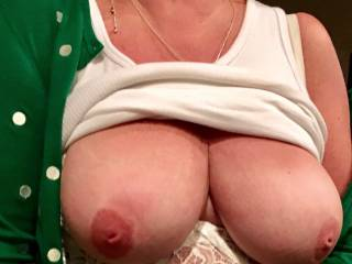 My wife and I were out for St. Patrick's Day.  She called me into a side room and lifted her shit.  My dick was so hard.  I sucked those tits good.
