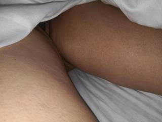 My husband's friend peeping under the sheets to see what he is going to eat in a while and