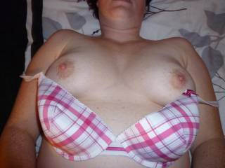 Wife slowly strips out of her bra and shows off her sexy tits
