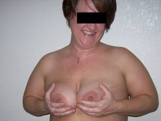 My date for the orgy showing off her tits for the camera