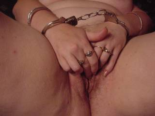 Wife playing with her pussy in handcuffs
