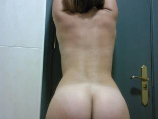 there's somewhere I'd love to slide my hard cock, what a cute butt!  To do that while you're up against the door would be very hot, don't you think? x