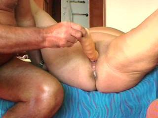 Wow!  What a great double vaginal penetration.  Do you have a desire to have two actual cocks in there some day?  We hope to do it with two cocks soon.  Until then we love it with our large dildos.  What a great fuck and what a wonderful view of you and your orgasm.  Thanks for sharing.