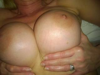 Mmm oh yes, let me grab some oil...stay right there, wow those are amazing tits