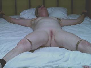 Hmmmm a dildo stuffed into her pussy and a guy straddling her face with a cock stuffed in her mouth :)