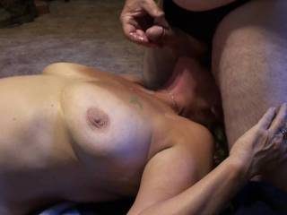 Gf sucking my balls, while I play with those big tits of hers. Then I blow a big warm load of cum all over her. Do you like having your balls sucked like this?