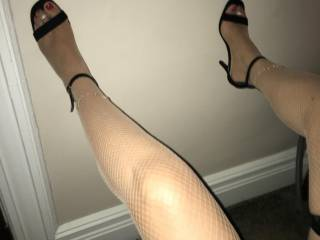 I love her feet. They make my cock hard. A little peak of her pussy.