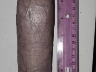 Fully erect I am exactly 9 inches long, 6.25 inches thick.