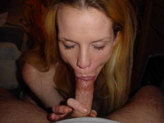 She looks Fantastic with a dick in her mouth! Great Action Shot!