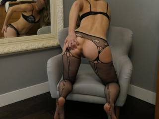 Just grab her sexy hips and slide into what she is holding open for you and watch the look of lust on her face in the mirror. What an amazing ass don\'t you think?