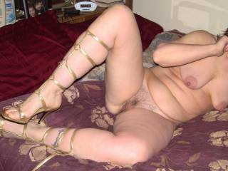 """what a gorgeously sexy woman!! I love her stunning """"Roman"""" heels, her yummy body and her sweet hairy pussy!!"""