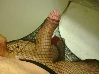 Fishnet pantyhose feel kinky and make my cock very hard!!!