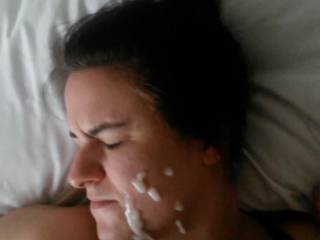 Dumping a load of cum all over her face