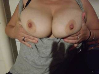 She loves playing with her titties